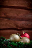 Christmas card with a gold and red toys Royalty Free Stock Photography