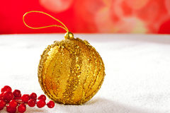 Christmas card of golden bauble berries on snow Stock Image