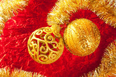 Christmas card golden bauble and tinsel on red. Christmas card golden bauble arabesque and tinsel on red background Royalty Free Stock Images