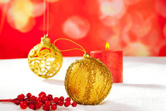 Christmas card of golden baubleand candle Stock Photos