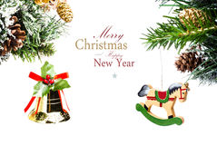 Christmas card with golden bell  and wooden horse with decoratio Royalty Free Stock Image