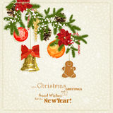 Christmas card with golden bells, red ribbon, fir branches. Royalty Free Stock Photos