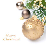 Christmas card with golden Christmas balls and fir branches Stock Images