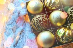 Christmas toys close-up in the box. Christmas decorations in gold color, the concept of Christmas, new year. stock photo