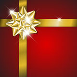 Christmas card - golden ribbon on red Royalty Free Stock Images