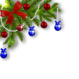 Christmas card. Green branches of a Christmas tree with blue, red balls and ribbon on a white background. Angular Royalty Free Stock Photo