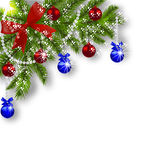 Christmas card. Green branches of a Christmas tree with blue, red balls and ribbon on a white background. Corner with Stock Photos