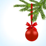 Christmas card. Green branches of a Christmas tree with red balls and ribbon on a white background. Christmas Stock Photo
