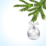 Christmas card. Green branches of a Christmas tree with silver balls and ribbon Stock Photo