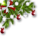 Christmas card. Green branches of a Christmas tree with silver, red balls and ribbon  Stock Photos