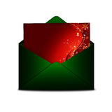 Christmas card in green envelope  over white Stock Image