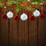 Christmas card with green fir branch. And red decorations on a wooden background. Vector illustration Royalty Free Stock Image