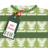 Christmas card with a green knitted sweater and price tag stock photo