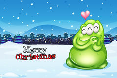 A christmas card with a green monster Stock Photos