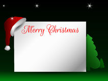 Christmas card. Christmas Greeting card with a Christmas hat on green background Royalty Free Stock Image