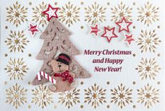 Christmas Card with Greetings Text, Vintage Ornament, Little Bear under the Tree and Stars.  royalty free stock photography