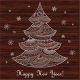 Christmas card with hand drawn decorated fir-tree on the wood Stock Photos