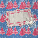 Christmas card. Hand-drawn label and paper snowflake  on patterned background with falling snow and stylized fir trees decorated with snowflakes, baubles and Stock Photos