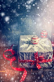 Christmas card with handmade gift boxes,  paper snowflakes and festive decorations. Royalty Free Stock Photography