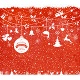 Christmas card with hanging ornaments on texture red background Stock Images