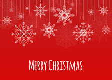 Christmas card with hanging snowflakes Royalty Free Stock Photos