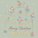 Christmas card. Christmas and Happy New Year greeting card with cute birds in winter caps sitting on branches stock illustration