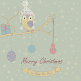 Christmas card. Christmas and Happy New Year greeting card with cuteowl in winter cap sitting on branch as on christmas tree with christmas decoration and gift vector illustration