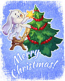Christmas card with a hare and a Christmas tree Stock Images