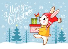 Christmas card with a hare which carries gifts. Stock Photography