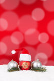 Christmas card hat decoration with fir branch, red background an Stock Images