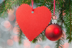 Christmas card with heart, ball and spruce twig Royalty Free Stock Photo