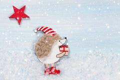 Christmas card with a hedgehog Royalty Free Stock Photos