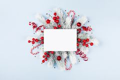 Christmas card with holiday decorations and fir tree stock images