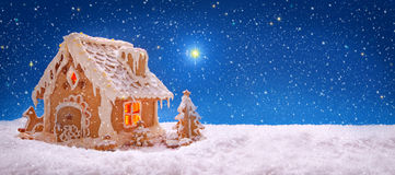 Christmas card.  Holiday Gingerbread house  . Winter Holiday Gingerbread house isolated on sky background Royalty Free Stock Photo