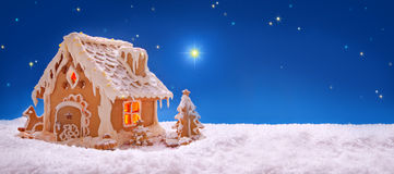 Christmas card.  Holiday Gingerbread house  . Winter Holiday Gingerbread house  on sky background Stock Photos