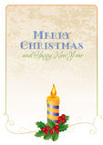 Christmas card with holly and candle Royalty Free Stock Image