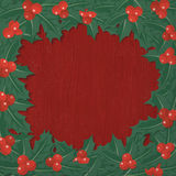 Christmas card with holly wreath Stock Photography