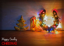 Christmas card with horseshoe and cookies on wood background Royalty Free Stock Photography