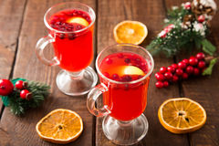 Christmas card. hot spicy Christmas drink of cranberry and spice Stock Photography