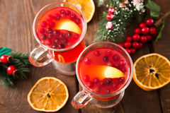 Christmas card. hot spicy Christmas drink of cranberry and spice Royalty Free Stock Image