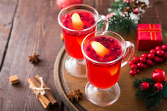 Christmas card. hot spicy Christmas drink of cranberry and spice Royalty Free Stock Images