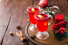 Christmas card. hot spicy Christmas drink of cranberry and spice Stock Photo