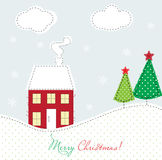 Christmas card with house and trees Royalty Free Stock Photos