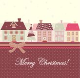 Christmas card with houses Royalty Free Stock Photography