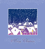 Christmas card with houses. Evening city at Christmas with snow Royalty Free Stock Image