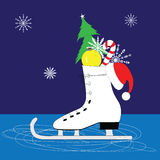 Christmas card. Ice skates with Christmas decorations Royalty Free Stock Images