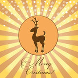 Christmas card with the image of a deer. Christmas card with the image of a brown deer on a yellow-beige background with snowflakes and letters Royalty Free Stock Photos