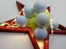 Christmas card inspired by golf framed by a red star Stock Photos