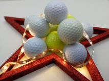 Christmas card inspired by golf framed by a red star Stock Images