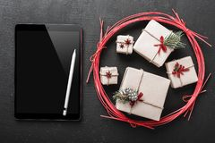 Christmas card, ipad you can write a message for loved ones off of new year gifts, then send a greeting message to your dear ipad. Stock Image